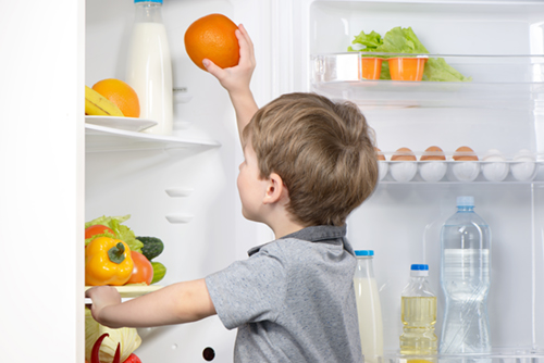 Little cute boy picking orange from fridge. Vegetables and fruits in the refrigerator; Shutterstock ID 266450780; PO: Cat Overman; Job: blog post