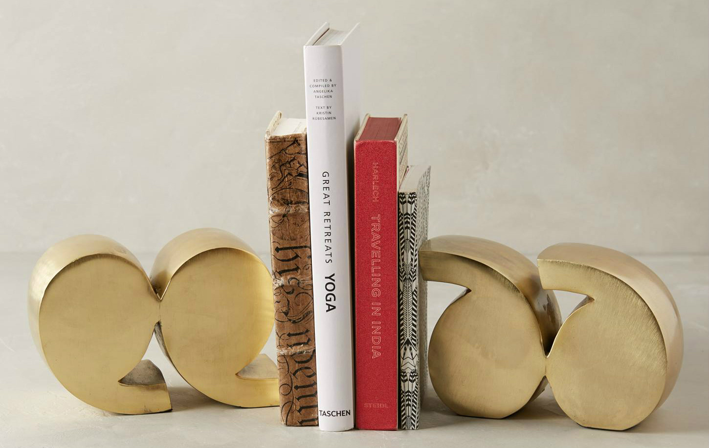 държач за книги - кавички