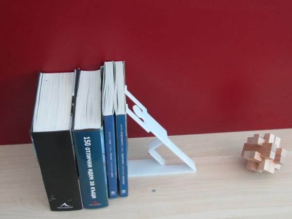 държач за книги - придържащо човече